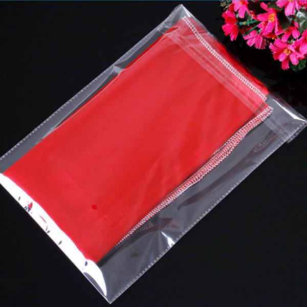 Sacos para embalar transparente com adesivo e furo barato